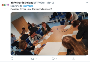 Screenshot of a tweet with YPAG members working on a sheet of paper